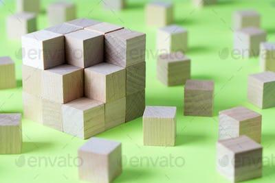 Wooden cubes form a bigger square