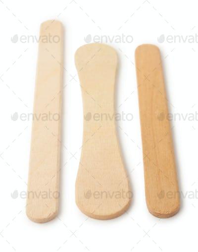Wooden ice cream sticks on white background