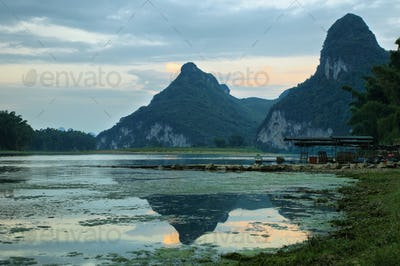 Karst mountains reflected in Li river at sunset