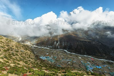 Dingboche village with Ama Dablan peak behind between clouds