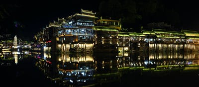 View of illuminated Wanming Pagoda in Fenghuang,