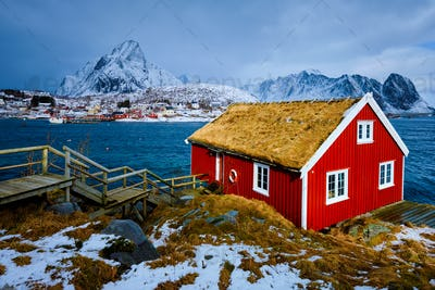 Traditional red rorbu house in Reine village on Lofoten Islands
