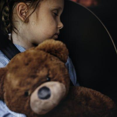 Little girl sleeping in the car