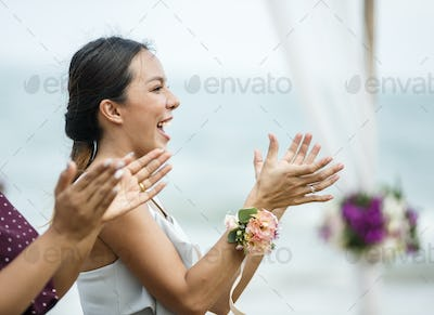 Wedding guests clapping for the bride and groom