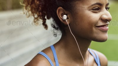 Girl smiling while listening to music