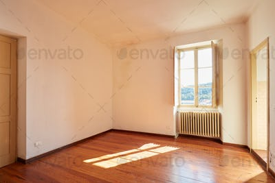 Old empty room with wooden floor in country house