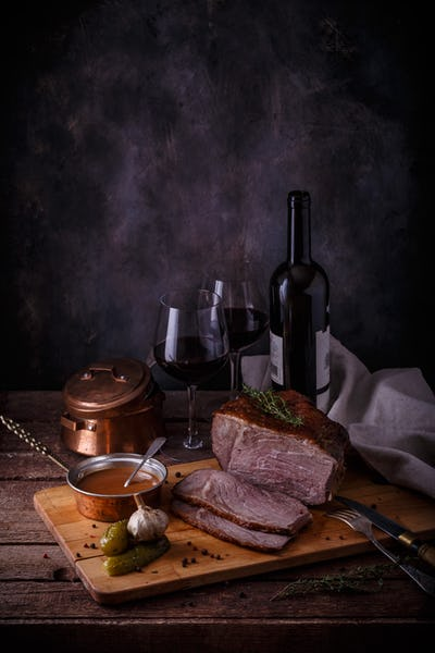 Baked meat on a wooden background. Roast beef, copy space