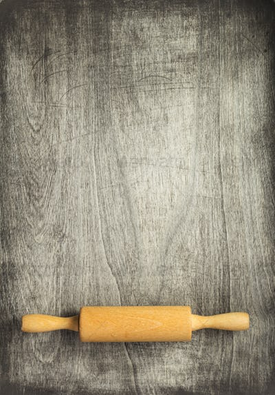 rolling pin at old wooden table