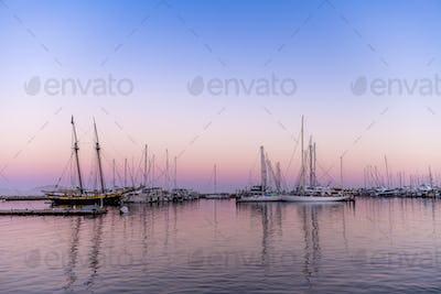 Sailboats in bay at sunset