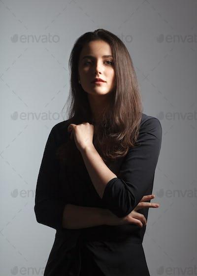 beautiful female studio portrait with deep shadows