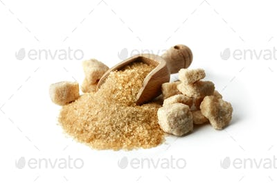 Brown cane sugar crystals in wooden scoop