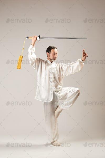 Senior master practicing qi qong taijiquan
