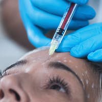 Hyaluronic Acid Injection. Cosmetic Anti-Aging Face Treatment