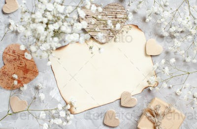 Gift box with small white flowers and hearts
