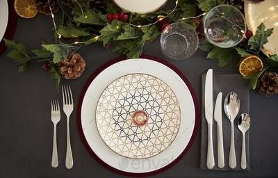 Christmas table place setting with bauble arranged on a plate