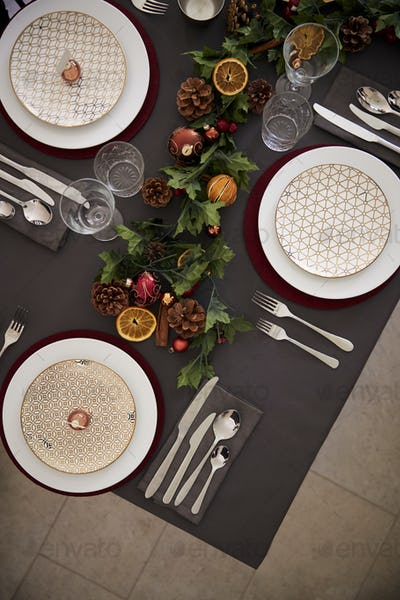 Christmas table setting with baubles arranged on plates