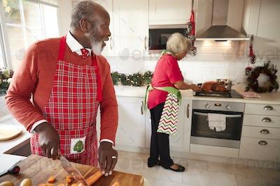 Mature black couple preparing Christmas dinner