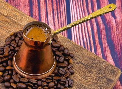 Black coffee in an old copper pan