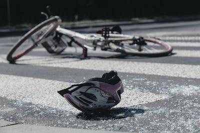 Broken child's helmet and bike on pedestrian crossing after terr