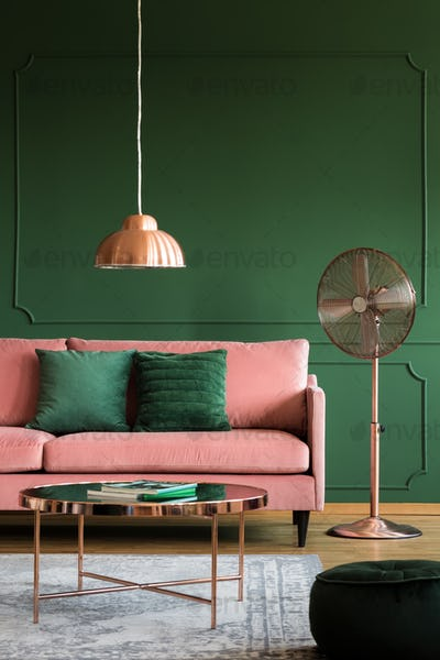 Copper accents in elegant pastel pink and emerald green interior