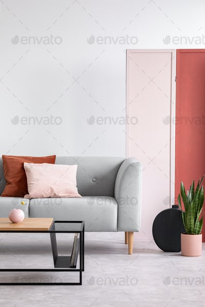 Pink and red screen on the white wall of elegant living room, mo