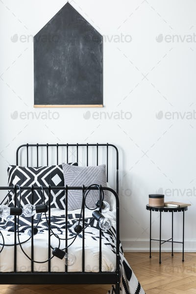 Vertical view of blackboard on the wall of teenagers bedroom wit