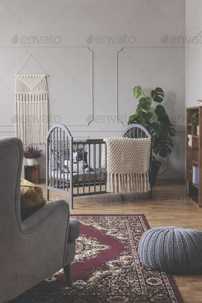 Vertical view of mid century baby room concept in grey vintage i