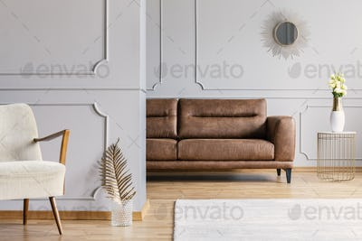 Open space living room interior with decorative mirror on wall w