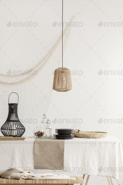 Lamp in a rustical dining room interior with a table and candleh