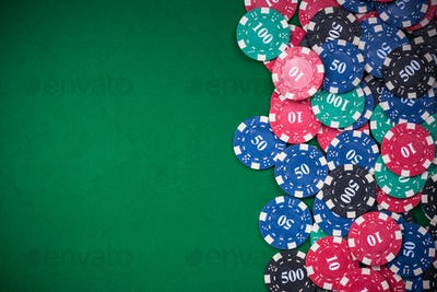 poker chips on green casino table, border background