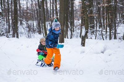 Two children boys playing outdoor in the park.