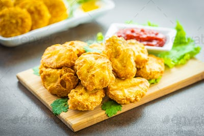 Deep fried chicken meat call nugget with tomato or ketchup sauce