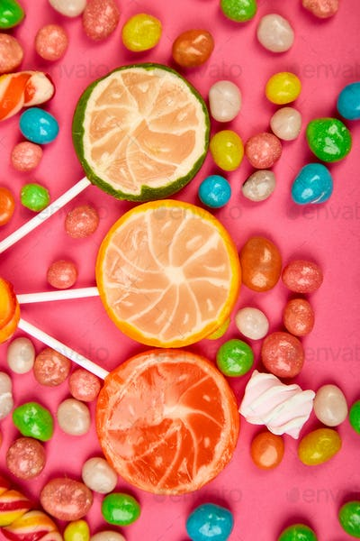 Colorful candy, jelly, lollipop on stick, scattering of multicolored sweets