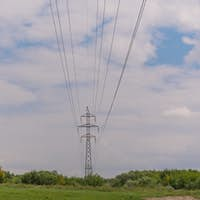 cloudy morning sky and a high-voltage line