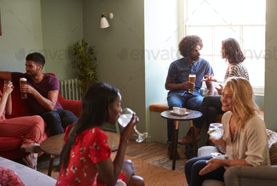 A group of people in a pub drinking and talking