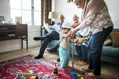 Muslim family relaxing in the home