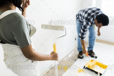 Man painting the walls yellow