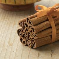 Bunch of cinnamon sticks with an orange ribbon