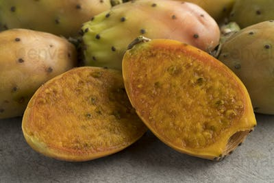 Fresh ripe yellow whole and half cactus fruit
