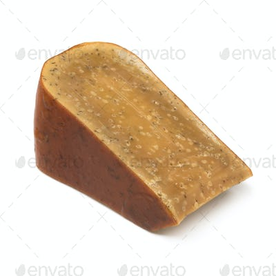 Piece of three years old Dutch cumin cheese