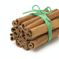 Bunch of cinnamon sticks with agreen cord