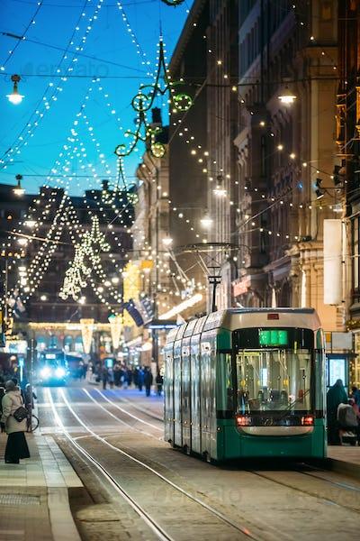 Helsinki, Finland. Tram Departs From Stop On Aleksanterinkatu St