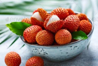 Fresh organic lychee fruit in a bowl