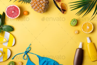 Beach accessories on yellow background. Summer vacation