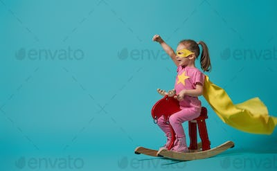 child playing superhero