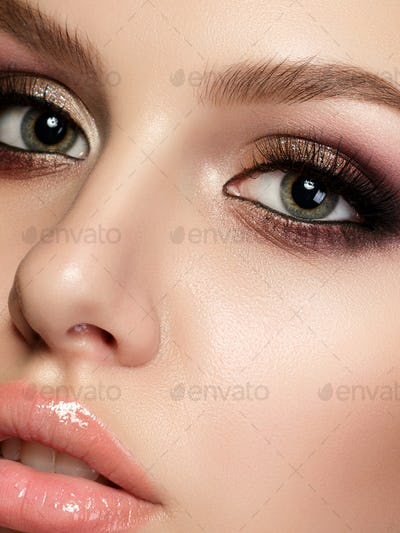 Young beautiful woman with evening make up
