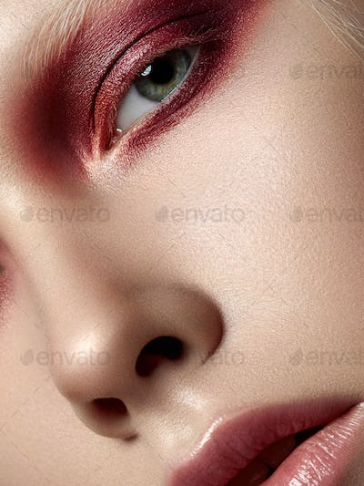 Young beautiful woman with fashion make up