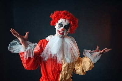 Portrait of scary bloody clown with crazy eyes