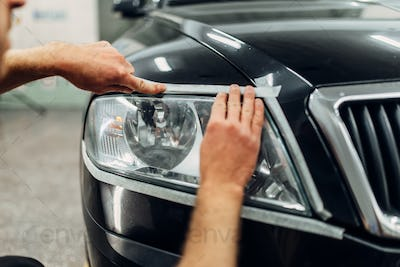 Auto detailing of car headlights, carwash service