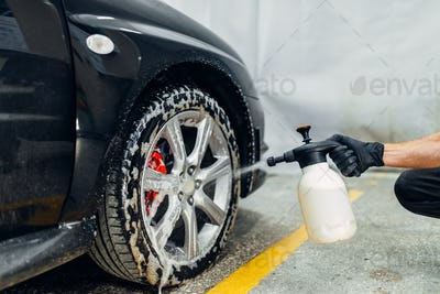 Carwash, cleaning the wheels with a special agent